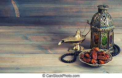 Dates, arabian lantern and rosary. Islamic holidays concept....