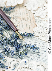 vintage ink pen, dried lavender flowers and old love letters...