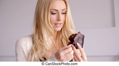 Pretty Smiling Blond Woman with Chocolate Cupcake - Close up...