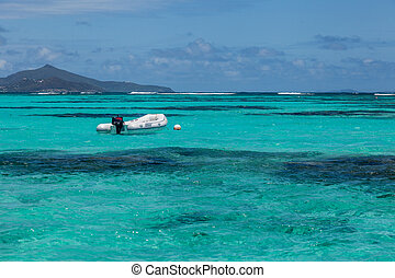 Lone Empty Dinghy Boat Floating Tropical Water - An empty...