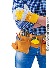 crossed arms of construction worker very close up isolated const