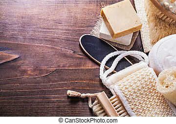 set of bath items on vintage wooden boards with organized...
