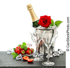 festive arrangement with champagne, red rose and...