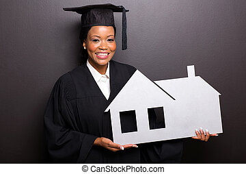 african american graduate holding home symbol isolated on...