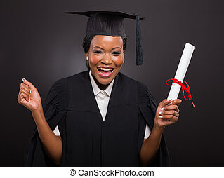 african university student holding her graduation certificate