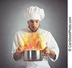 Chef blowing burnt food - Chef blowing his burnt food in pot