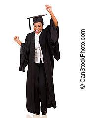 african college student in graduation gown dancing - happy...