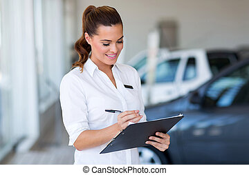 saleswoman working at car dealership - pretty saleswoman...