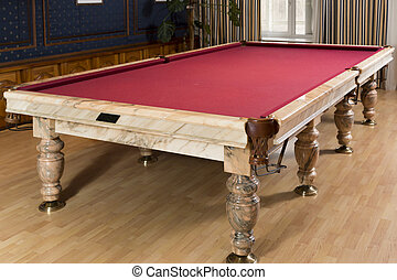 Luxurious marble pool table with a red cloth for billiard in...