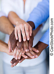 group of business people hands together - multiracial group...