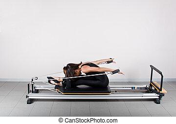 Gymnastics pilates - Back reach seated position. Pilates...