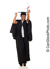 excited african graduate dancing isolated on white...