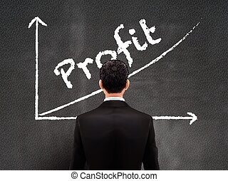 businessman looking at profit graph