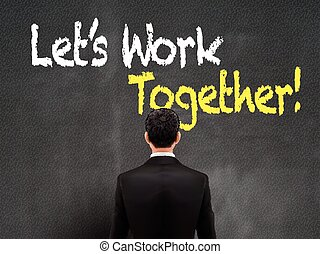 businessman looking at let us work together words