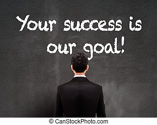 businessman looking at your success is our goal words on...