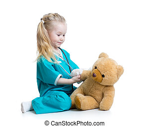 child girl playing doctor with plush toy isolated