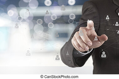 businessman hand showing human icon flow chart on new modern com