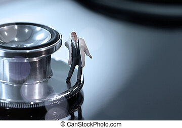 Modern medical concept-studio macro of miniature doctor with...