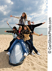 Five friends on the boat - Group of five smiling teenagers...