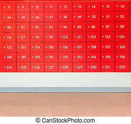 Rows of red  post office boxes.