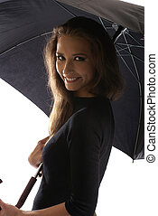 Young lovely georgian woman with umbrella isolated on white...