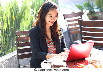 Young businesswoman work oudoor, in a cafe - A portrait of a...