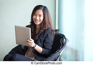 Happy young Businesswoman with a tablet pc