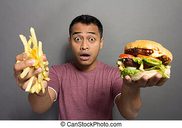 young man surprised with the size of his burger portion package