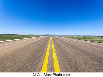 wide road in prairie