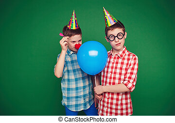 Goofy twins - Goofy child going to burst balloon of his...