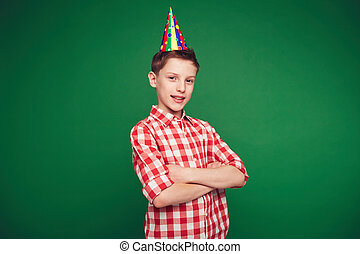 Handsome boy - Happy kid with birthday cap looking at camera