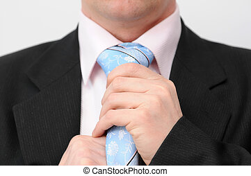 Man doing tie - Closeup of businessman doing a blue tie....