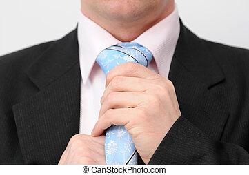 Man doing tie - Closeup of businessman doing a blue tie....