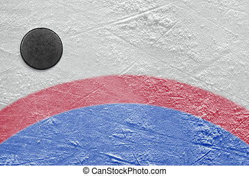Goalmouth and hockey puck - The puck lying on a hockey rink....