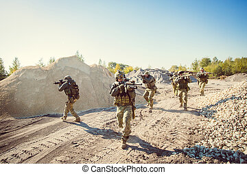 Soldiers team is fighting on the territory occupied by the...
