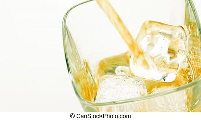 pouring whiskey on white background