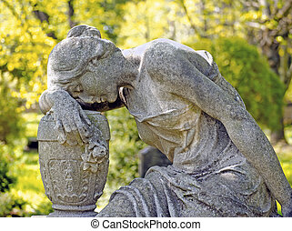 cemetery - statue of a sad woman on a cemetery