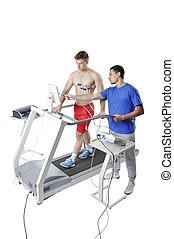 Sports Scientist doing Performance Assessment on Treadmill....