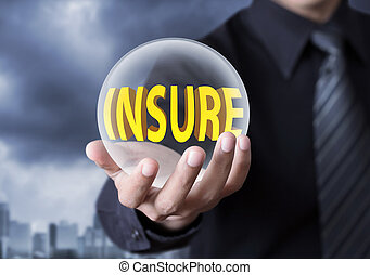 Insurance concept - Businessman's hand holding crystal ball...