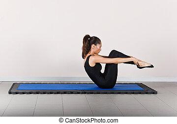 Gymnastics pilates - Rolling position. Pilates gymnastics is...
