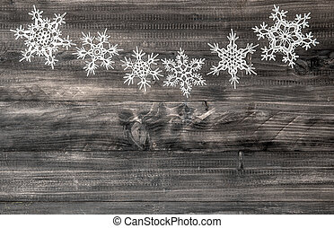 white snowflakes on wooden background christmas decoration -...