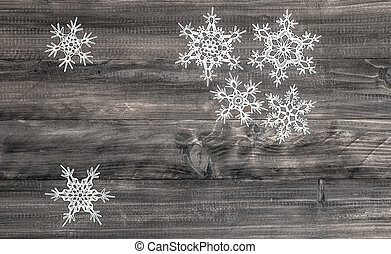 christmas decoration white snowflakes on wooden background -...