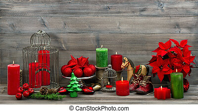vintage christmas decorations with red candles and flower...