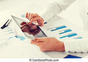 woman with tablet pc and chart papers - business, office,...