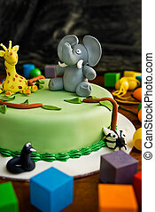 Childs Birthday Cake - Jungle themed birthday cake with an...
