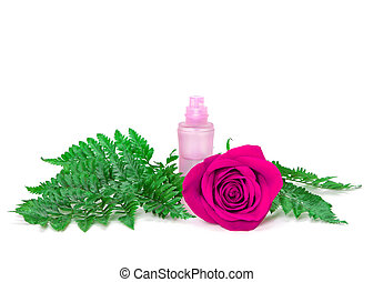 Perfume bottle with fresh purple rose and fern leaves - Open...
