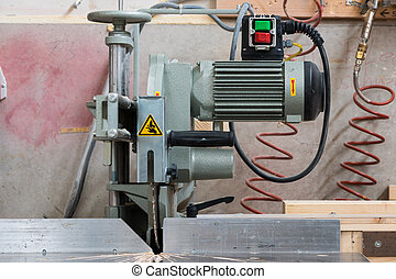fixed circular buzz saw with electric motor engine and green...