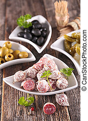 buffet food with sausage and olives