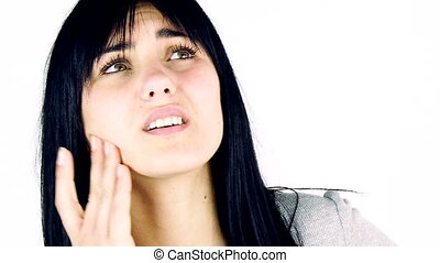 woman feeling strong teeth ache - Young brunette woman...
