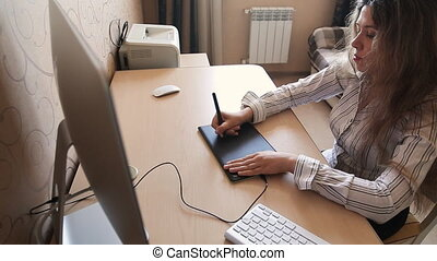 Woman interior designer working at the home office